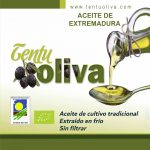 Olive oil is poured from a bottle into a spoon.